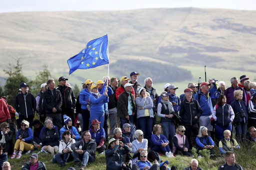 Golf fans cheers on their teams in the Solheim cup match between Europe and the U.S at Gleneagles, Auchterarder, Scotland, Friday, Sept. 13, 2019. (AP Photo/Peter Morrison)