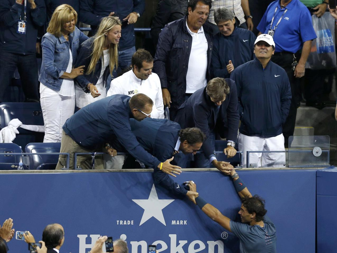 Rafael Nadal of Spain greets friends and family in the stands as he celebrates after defeating Novak Djokovic of Serbia in their men's final match at the U.S. Open tennis championships in New York, September 9, 2013. REUTERS/Adam Hunger (UNITED STATES - Tags: SPORT TENNIS)