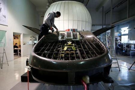 A worker works on a prototype of the Cormorant at Urban Aeronautics' workshop in Yavne
