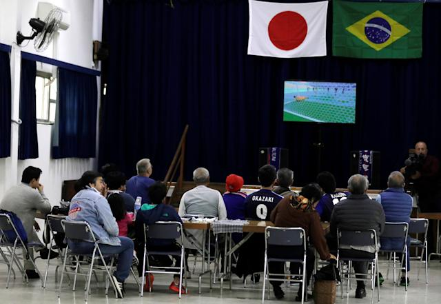 Japanese descendants watch the broadcast of the World Cup Group H soccer match between Japan and Colombia at Liberdade, a Japanese neighbourhood in Sao Paulo, Brazil June 19, 2018. REUTERS/Paulo Whitaker