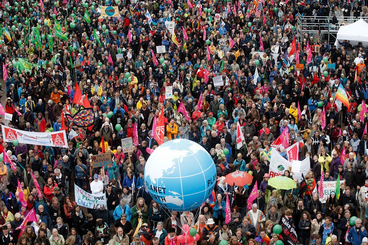 <p>Participants of the demonstration 'G20 Protest Wave' gather in Hamburg, Germany, Sunday, July 2, 2017 to protest against the upcoming G20 summit on July 7 and July 8, 2017. (Markus Scholz/dpa via AP) </p>