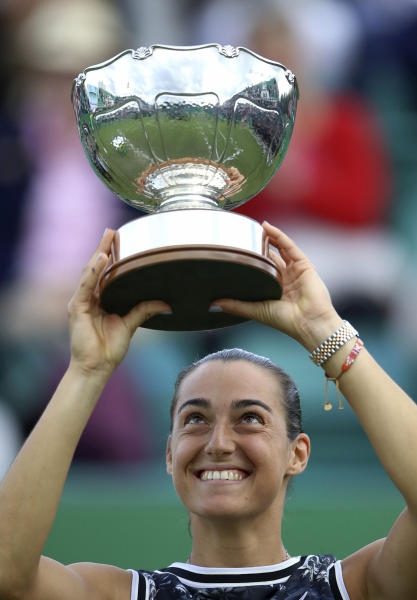 France's Caroline Garcia lifts the trophy after beating Croatia's Donna Vekic, to win the women's singles final during day nine of the Nottingham Cup Open tennis championship in Nottingham, England, Sunday June 16, 2019. (Tim Goode/PA via AP)
