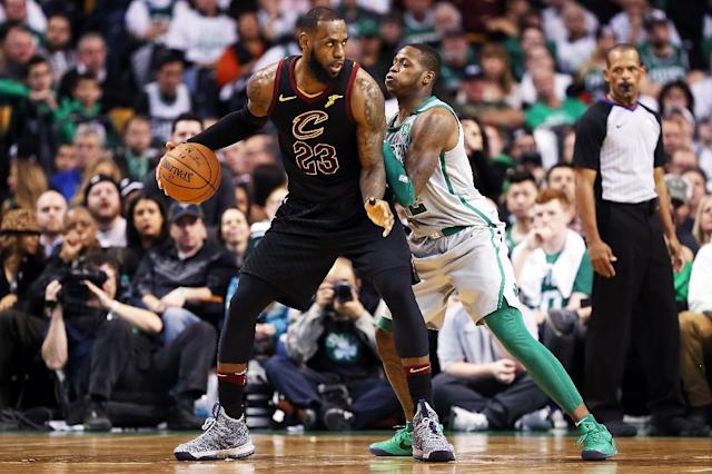 Cleveland's Lebron James is guarded by Terry Rozier of the Boston Celtics as the Cavaliers routed the Celtics 121-99 (AFP Photo/Adam Glanzman)
