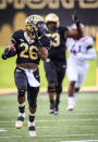 Wake Forest running back Christian Beal-Smith (26) runs the ball during an NCAA college football game against Virginia Tech on Saturday, Oct. 24, 2020 at Truist Field in Winston-Salem, N.C. (Andrew Dye/The Winston-Salem Journal via AP)