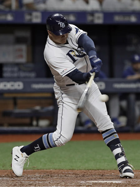 Tampa Bay Rays' Avisail Garcia connects for a three-run home run off Los Angeles Dodgers relief pitcher Dylan Floro during the seventh inning of a baseball game Wednesday, May 22, 2019, in St. Petersburg, Fla. (AP Photo/Chris O'Meara)