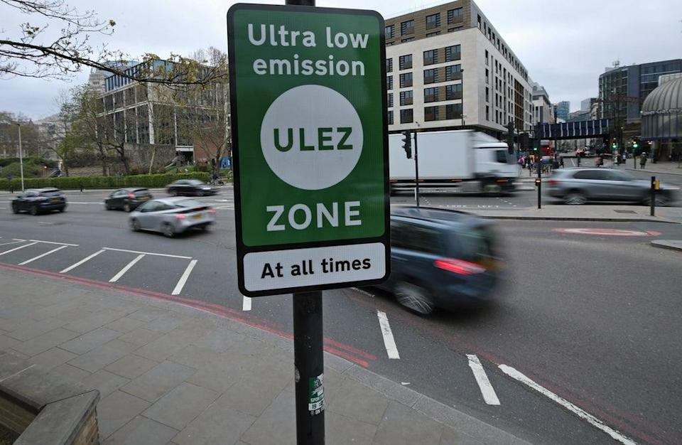 An Ultra Low Emission Zone information sign at Tower Hill in central London (PA) (PA Archive)