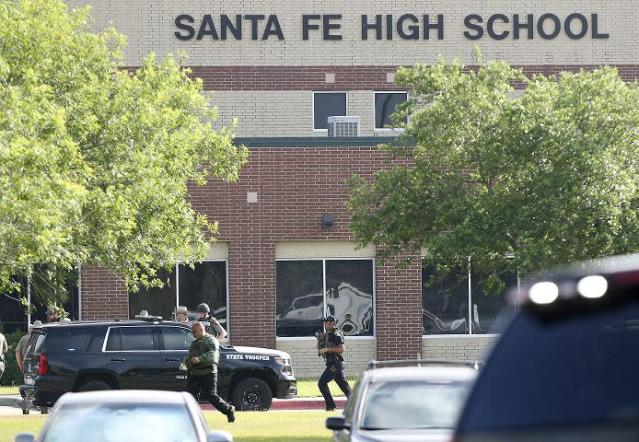 Emergency responders respond to an active shooter in front of Santa Fe High School. (AP/Houston Chronicle )