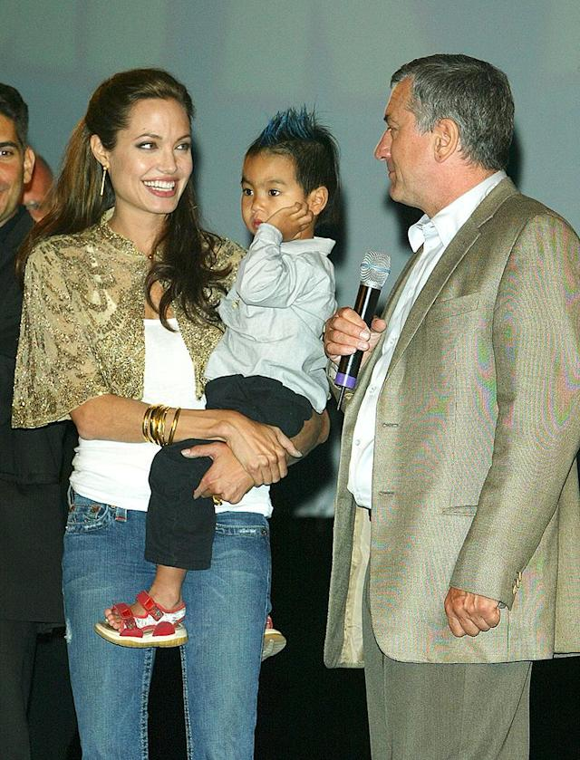 <p>Maddox looks a little different here, right? This was at the 2004 premiere of <em>Shark Tale</em>, for which the actress voiced a character, at the Venice Film Festival, and it was a year after she adopted Maddox from Cambodia. It was a busy year for Angelina as a new mom — as she divorced Billy Bob Thornton soon after she brought home Mad. And soon after this photo was taken, she fell in love with her <em>Mr. & Mrs. Smith</em> co-star Brad Pitt, he adopted Mad, and they went on to build a (big) fam. (Photo: Pascal Le Segretain/Getty Images) </p>