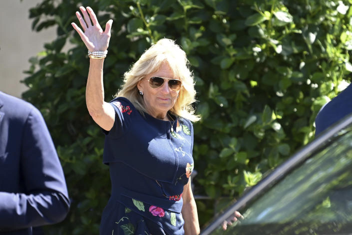 US First Lady Jill Biden waves after meeting military surfers in Newlyn, Cornwall, England, on the sidelines of the G7 summit, Saturday June 12, 2021. US First Lady Jill Biden met with veterans, first responders and family members of Bude Surf Veterans, a Cornwall-based volunteer organization that provides social support and surfing excursions for veterans, first responders and their families. (Daniel Leal-Olivas/Pool via AP)