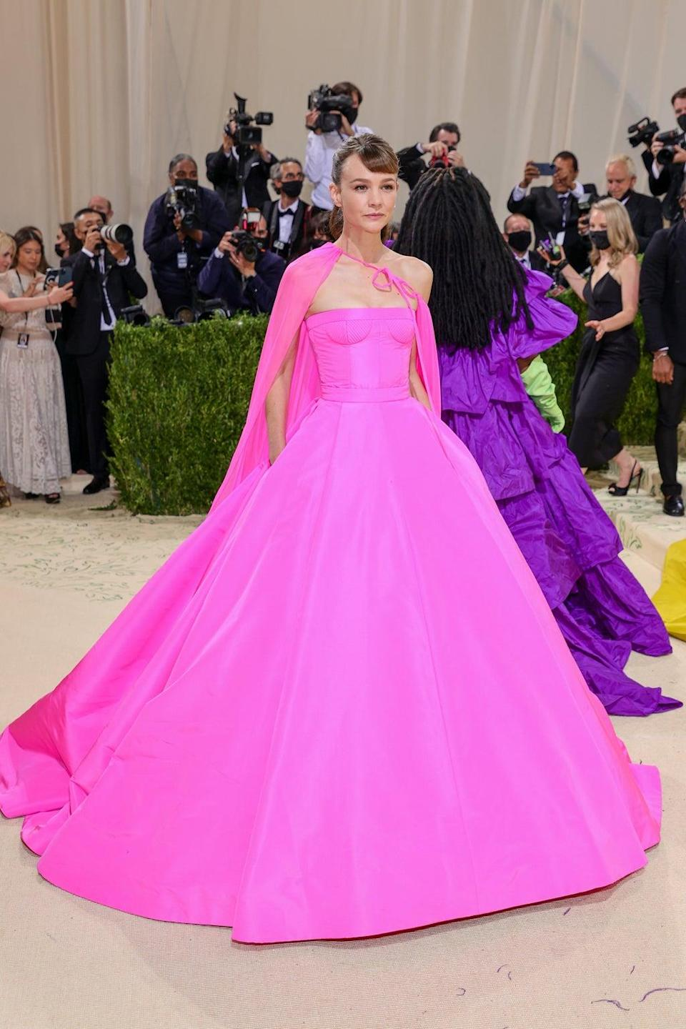 The 'Promising Young Woman' star wore a bright pink gown. (Getty)