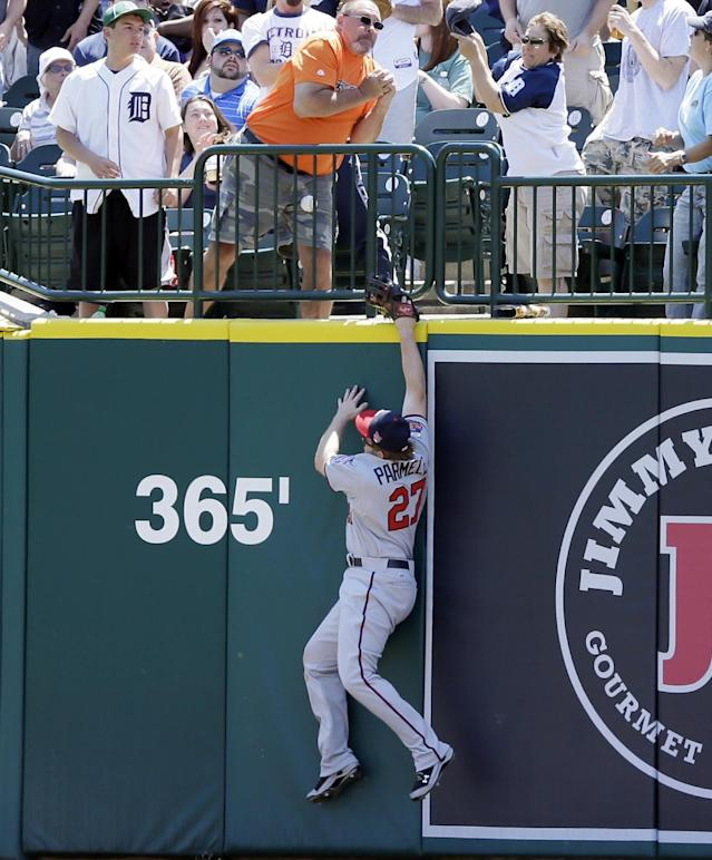 Minnesota Twins right fielder Chris Parmelee reaches but is unable to catch a 3-run home run by Detroit Tigers' Miguel Cabrera during the second inning of a baseball game in Detroit, Saturday, May 10, 2014. (AP Photo/Carlos Osorio)