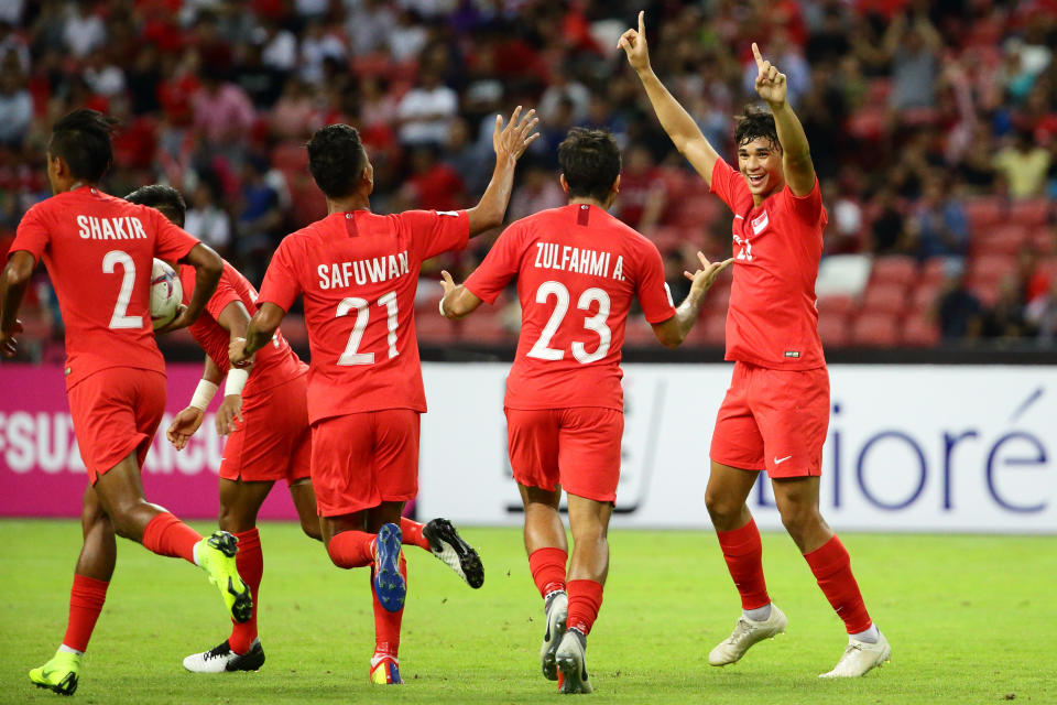 Singapore national striker Ikhsan Fandi (right) celebrates with his teammates during the AFF Suzuki Cup tournament in 2018