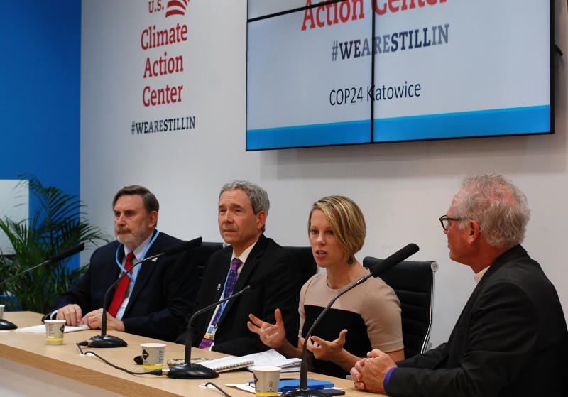 Ashley Allen, Climate and Land Senior Manager at Mars Incorporated, second from right, speaks at the launch of the U.S. Climate Action Center in Katowice, Poland, on Friday, Dec 7, 2018. Others on the podium are, from left, William Somplatsky-Jarman, Presbyterian Church, Patrick Hamilton, Minnesota Science Museum, and Bishop Marc Andrus, Episcopal Church. (AP Photo/Frank Jordans)