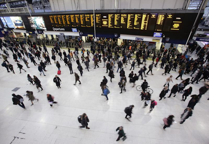 Commuters at Waterloo station in London, as workers in five rail companies stage a fresh wave of strikes in the bitter disputes over the role of guards, causing disruption to services in the first full week back to work after the festive break.