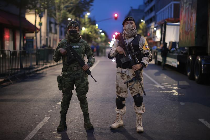 VARIOUS CITIES, MEXICO - SEPTEMBER 16: Mexican soldiers pose during the Independence Day military parade at Zocalo Square on September 16, 2020 in Various Cities, Mexico. This year El Zocalo remains closed for general public due to coronavirus restrictions. Every September 16 Mexico celebrates the beginning of the revolution uprising of 1810. (Photo by Hector Vivas/Getty Images)