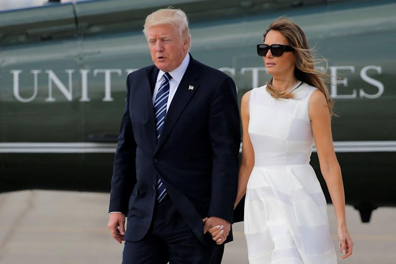 U.S. President Donald Trump and first lady Melania Trump hold hands as they arrive to board Air Force One for travel to Rome from Ben Gurion International Airport in Tel Aviv, Israel on May 23.