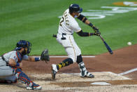 Pittsburgh Pirates' Erik Gonzalez (2) hits a two-run homer in front of Detroit Tigers catcher Austin Romine in the fourth inning of a baseball game, Friday, Aug. 7, 2020, in Pittsburgh. (AP Photo/Keith Srakocic)