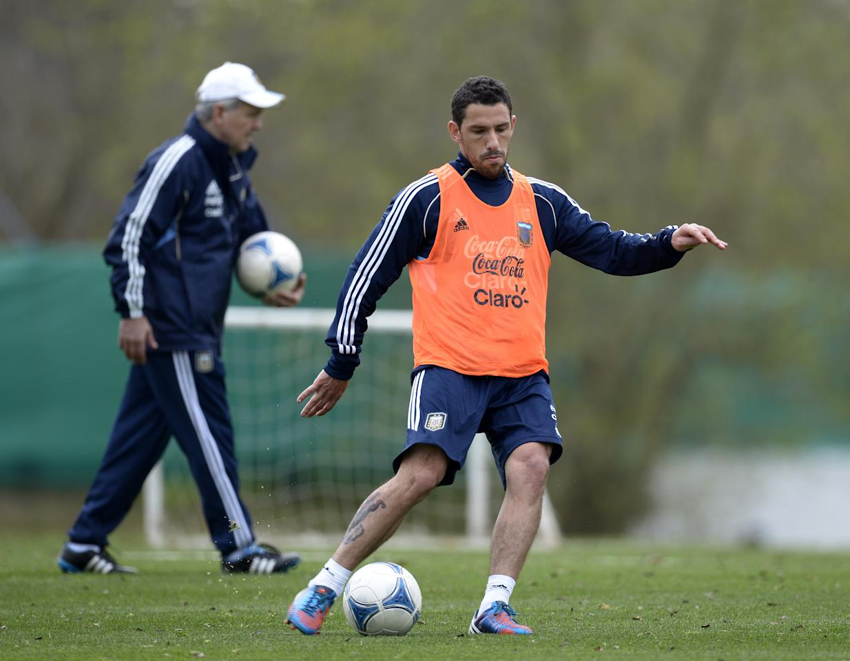 Argentina's midfielder Maximiliano Rodriguez strikes the ball during a training session of the national football team in Ezeiza, Buenos Aires, on September 4, 2012 ahead of the Brazil 2014 World Cup South American qualifier match against Paraguay to be held in Cordoba on September 7. AFP PHOTO / Juan MABROMATAJUAN MABROMATA/AFP/GettyImages
