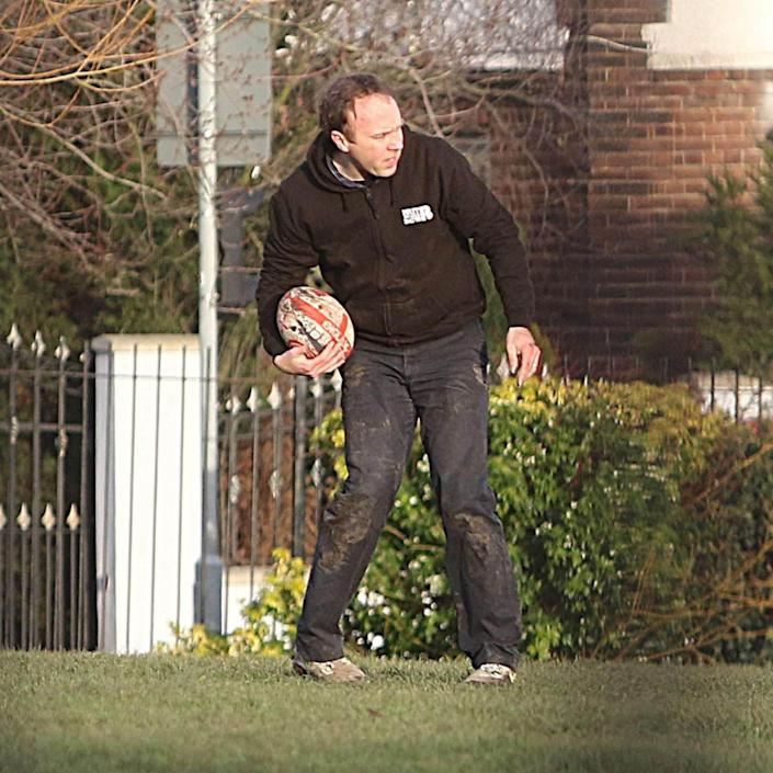 Matt Hancock and his two sons went to a park across the street from his London home to play rugby - Greg Brennan