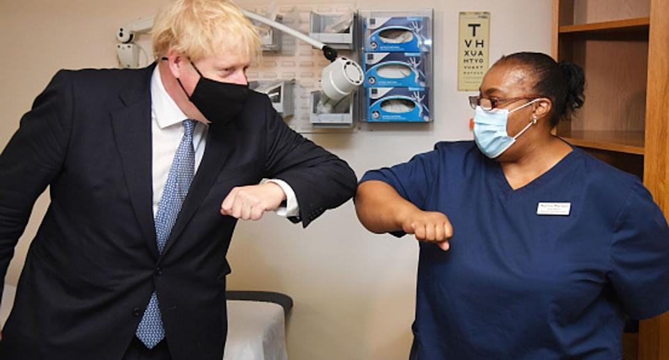 The PM was pictured at Tollgate Medical Centre in London on Friday