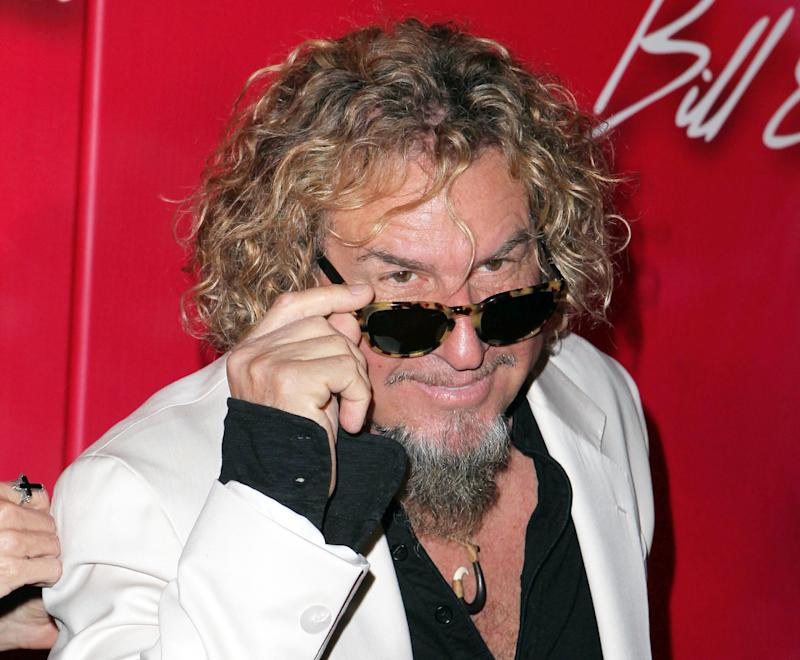"FILE - This Feb. 18, 2012 file photo shows recording artist Sammy Hagar at the Keep Memory Alive 16th Annual ""Power of Love Gala"" honoring Muhammad Ali in Las Vegas.  A defamation lawsuit against Sammy Hagar filed by a former Playboy bunny who claims he fathered her child has been dismissed, and the former Van Halen frontman is pleased with the result, his attorney said Monday, May 6, 2013. (AP Photo/Jeff Bottari, file)"
