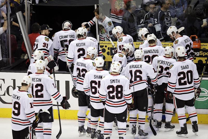 The Chicago Blackhawks players leave after their team's 5-2 loss to the Los Angeles Kings in Game 4 of the Western Conference finals of the NHL hockey Stanley Cup playoffs on Monday, May 26, 2014, in Los Angeles. (AP Photo/Jae C. Hong)