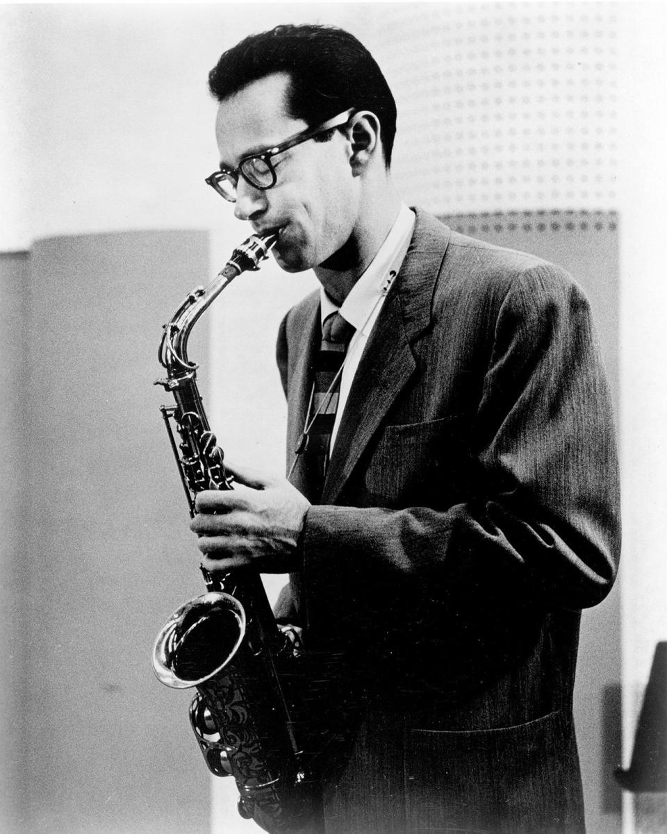 """<p>Alto saxophonist Paul Desmond was one of the most popular musicians out of the West Coast's """"cool jazz"""" scene, a style that arose after World War II. His music is characterized by relaxed tempos and a lighter style than the famous bebop performers. Desmond was drafted into the U.S. Army band out of high school, where he mastered his instrument in the large ensemble. With his sharp, dapper looks, Desmond was known to be a hit with the ladies — and it's not hard to see why. <i>(Photo: Getty Images)</i></p>"""