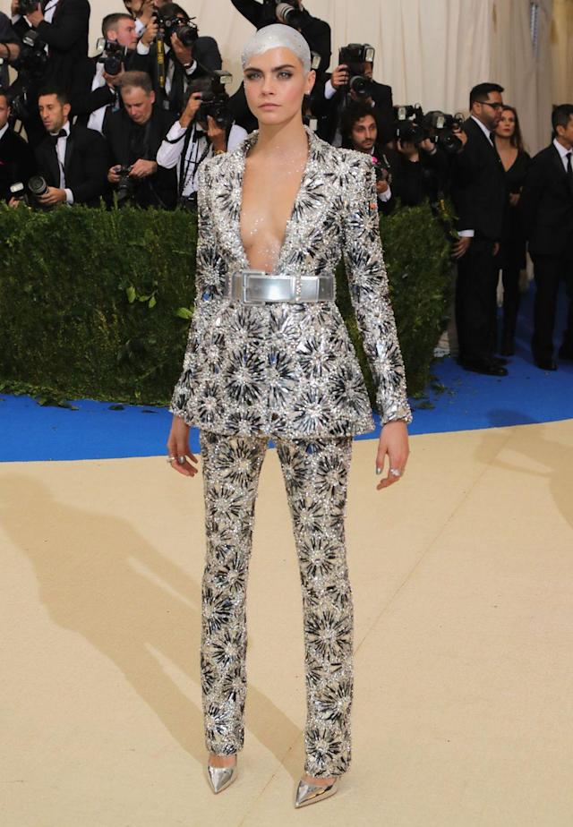 <p>The model wore a Chanel haute couture suit to the 2017 Met Gala. What was particularly captivating about this look was the sleek silver painted hair in one of the most memorable beauty looks in Met Gala history. </p>