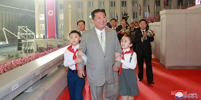 """In this photo provided by the North Korean government, North Korean leader Kim Jong Un walks with children during a celebration of the nation's 73rd anniversary at Kim Il Sung Square in Pyongyang, North Korea, early Thursday, Sept. 9, 2021. Independent journalists were not given access to cover the event depicted in this image distributed by the North Korean government. The content of this image is as provided and cannot be independently verified. Korean language watermark on image as provided by source reads: """"KCNA"""" which is the abbreviation for Korean Central News Agency."""