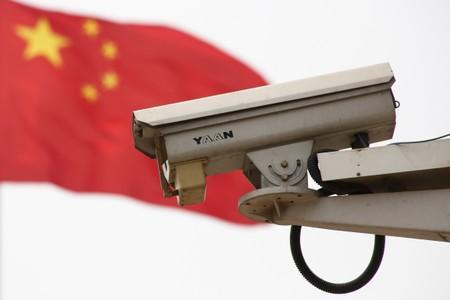 The Chinese national flag flies near a security camera on Beijing's Tiananmen Square