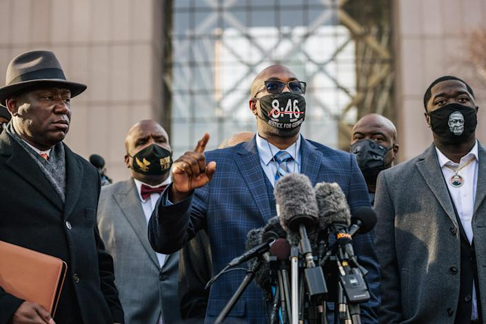 Image: Philonise Floyd, brother of George Floyd, speaks alongside attorney Ben Crump, left, and Brandon Williams, nephew of George Floyd, during a news conference outside the Hennepin County Government Center on March 29, 2021 in Minneapolis. (Brandon Bell / Getty Images)