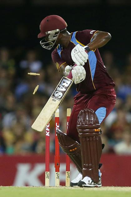 BRISBANE, AUSTRALIA - FEBRUARY 13:  Johnson Charles of West Indies is bowled by Nathan Coulter-nile of Australia during the International Twenty20 match between Australia and the West Indies at The Gabba on February 13, 2013 in Brisbane, Australia.  (Photo by Chris Hyde/Getty Images)