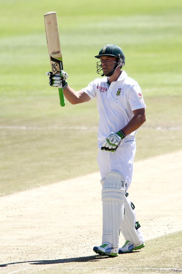 CAPE TOWN, SOUTH AFRICA - FEBRUARY 16:  AB de Villiers of South Africa raises his bat after reaching his fifty during day 3 of the 2nd Sunfoil Test match between South Africa and Pakistan at Sahara Park Newlands on February 16, 2013 in Cape Town, South Africa. (Photo by Shaun Roy/Gallo Images/Getty Images)