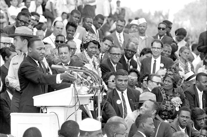 "Martin Luther King Jr., head of the Southern Christian Leadership Conference, addresses thousands of civil rights supporters gathered in front of the Lincoln Memorial for the March on Washington on Aug. 28, 1963. Actor-singer Sammy Davis Jr., lower right, was there for King's ""I Have a Dream"" speech."