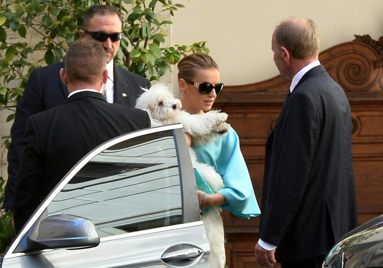 Former prime minister Silvio Berlusconi's most famous dog Dudu, held by his girlfriend Francesca Pascale (AFP Photo/ALBERTO PIZZOLI)