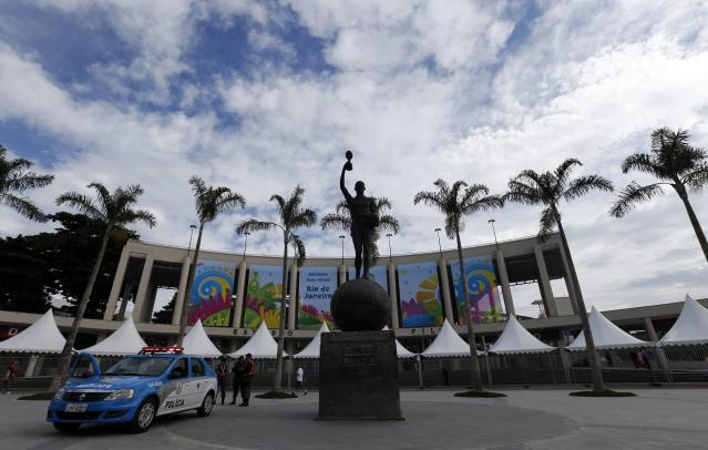 The main entrance of Maracana stadium, one of the stadiums hosting the 2014 World Cup soccer matches, is pictured before a press visit in Rio de Janeiro, May 26, 2014. REUTERS/Sergio Moraes (BRAZIL - Tags: SPORT SOCCER WORLD CUP)