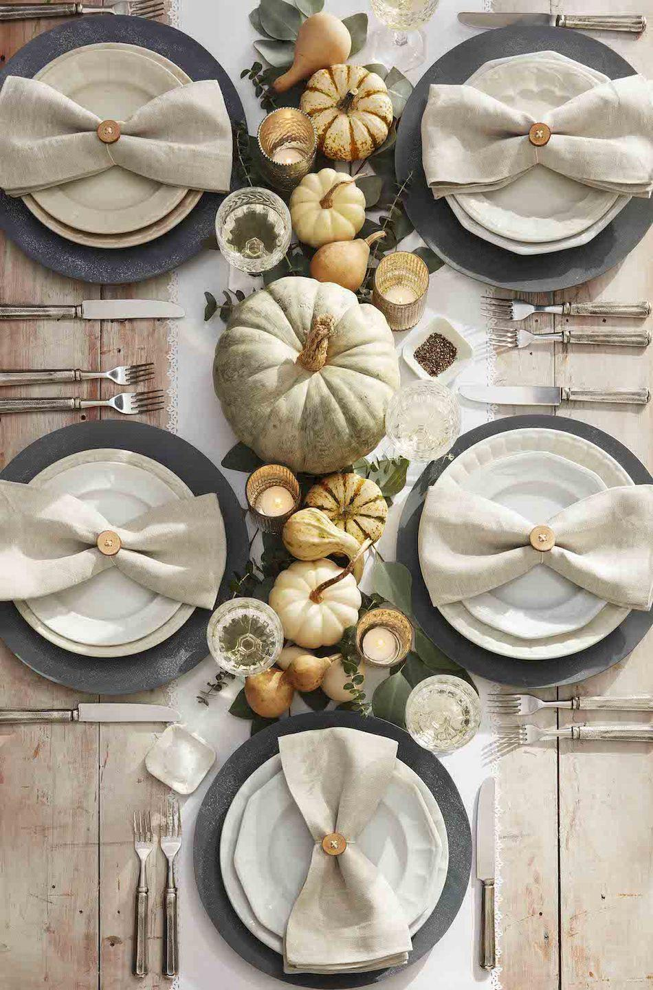 """<p>If bright orange and black isn't your favorite color combo, invoke the spirit of Halloween with whitewash painted pumpkins and a mix of neutral mini pumpkins and gourds.</p><p><strong><a class=""""link rapid-noclick-resp"""" href=""""https://www.amazon.com/YOFIT-Artificial-Decoration-Thanksgiving-Decorations/dp/B07VJBJFYK/?tag=syn-yahoo-20&ascsubtag=%5Bartid%7C10050.g.3739%5Bsrc%7Cyahoo-us"""" rel=""""nofollow noopener"""" target=""""_blank"""" data-ylk=""""slk:SHOP MINI WHITE PUMPKINS"""">SHOP MINI WHITE PUMPKINS</a></strong></p>"""