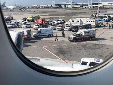 The emergency services are seen after the passengers were taken ill on a flight from New York to Dubai on JFK Airport New York U.S