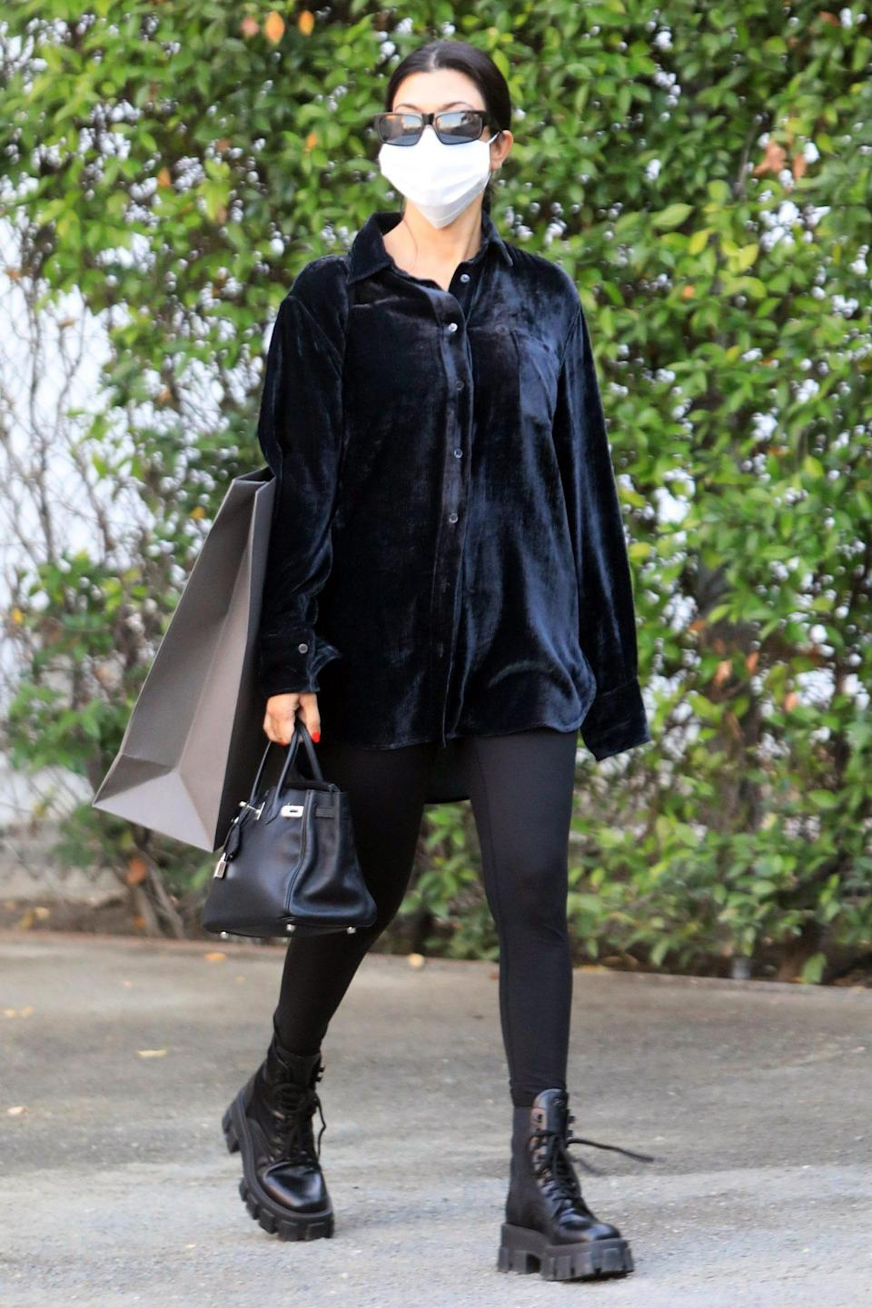 <p>Kourtney Kardashian goes shopping in L.A. on Thursday, wearing all black. </p>