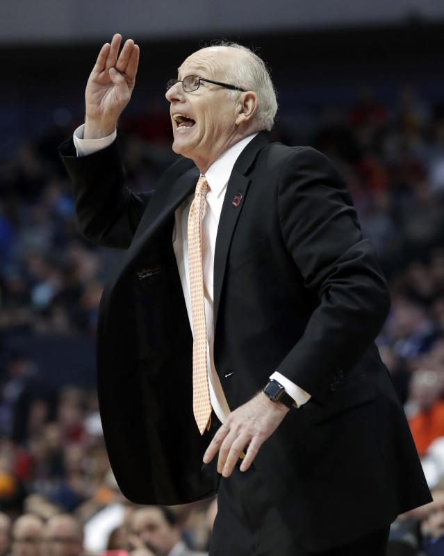 Miami coach Jim Larranaga gestures to his team during the second half of a first-round game against Loyola-Chicago at the NCAA college basketball tournament in Dallas, Thursday, March 15, 2018. (AP Photo/Tony Gutierrez)
