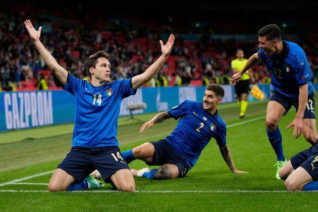 Italy's midfielder Federico Chiesa (L) celebrates after scoring the first goal during the UEFA EURO 2020 round of 16 football match between Italy and Austria at Wembley Stadium in London on June 26, 2021. (Photo by Frank Augstein / POOL / AFP) (Photo by FRANK AUGSTEIN/POOL/AFP via Getty Images) (Photo: FRANK AUGSTEIN via Getty Images)