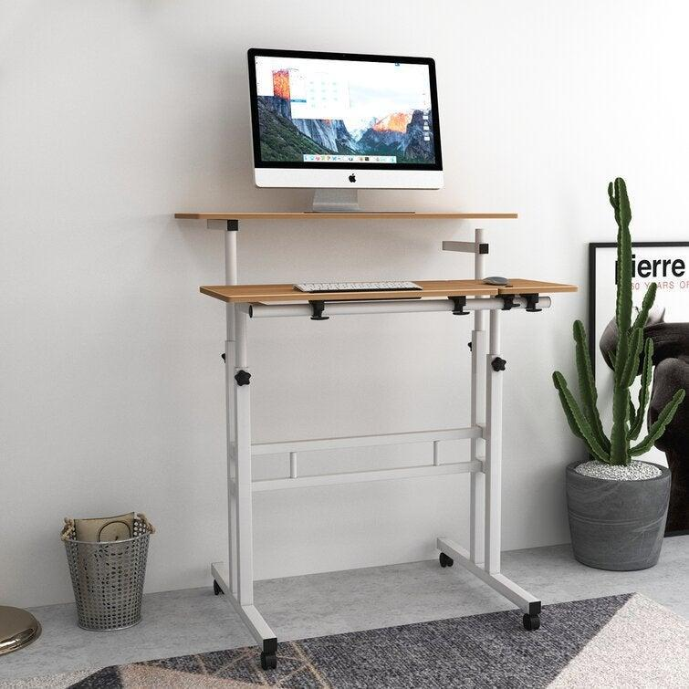 """<h2>Best Standing Desk Under $100</h2><br><h3>Inbox Zero Sit-Stand Cart Mobile Height Adjustable Standing Desk</h3><br><strong>The Hype</strong>: 4.1 out of 5 stars and 76 reviews on <a href=""""https://www.wayfair.com/furniture/pdp/inbox-zero-sit-stand-cart-mobile-height-adjustable-standing-desk-w003333390.html"""" rel=""""nofollow noopener"""" target=""""_blank"""" data-ylk=""""slk:Wayfair"""" class=""""link rapid-noclick-resp"""">Wayfair</a><br><br><strong>WFH Heroes Say:</strong> """"This is perfect for allowing me to work standing up at home. Saved my lower back! I maxed its height adjustment to get to the right ergonomic level and I'm 5'9"""". Highly recommend as it is a great value for the price.""""<br><br><em>Shop</em> <strong><em><a href=""""https://www.wayfair.com/brand/bnd/inbox-zero-b55652.html"""" rel=""""nofollow noopener"""" target=""""_blank"""" data-ylk=""""slk:Inbox Zero"""" class=""""link rapid-noclick-resp"""">Inbox Zero</a></em></strong><br><br><strong>Inbox Zero</strong> Sit-Stand Cart Mobile Height Adjustable Standing Desk, $, available at <a href=""""https://go.skimresources.com/?id=30283X879131&url=https%3A%2F%2Fwww.wayfair.com%2Ffurniture%2Fpdp%2Finbox-zero-sit-stand-cart-mobile-height-adjustable-standing-desk-w003333390.html"""" rel=""""nofollow noopener"""" target=""""_blank"""" data-ylk=""""slk:Wayfair"""" class=""""link rapid-noclick-resp"""">Wayfair</a>"""