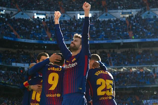 "Barcelona's Spanish defender Gerard Pique celebrates after Barcelona's Spanish midfielder Aleix Vidal scored during the Spanish League ""Clasico"" football match against Real Madrid (AFP Photo/CURTO DE LA TORRE)"