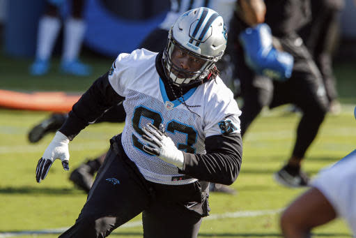 FILE - In this June 11, 2019, file photo, Carolina Panthers defensive tackle Gerald McCoy runs a drill during NFL football practice in Charlotte, N.C. McCoy will face his former team, the Tampa Bay Buccaneers, on Thursday night as a member of the Panthers. McCoy played nine season for Tampa Bay and went to six Pro Bowls and named All-Pro three times.(AP Photo/Nell Redmond, File)