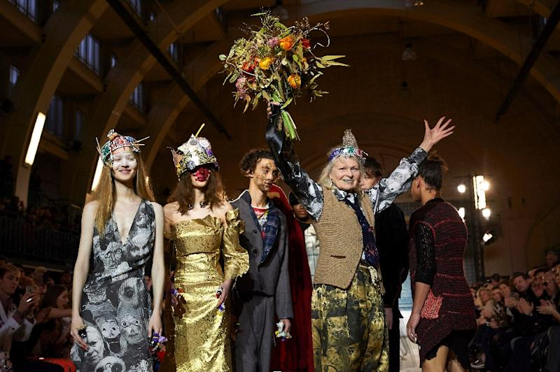 British fashion designer Vivienne Westwood (R) greets the audience following her show on the final day of the Autumn/Winter 2017 London Fashion Week Men's fashion event , which included both male and female models, on January 9, 2017