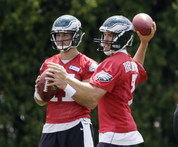 Tim Tebow (L) is in the running for a roster spot.  (AP)