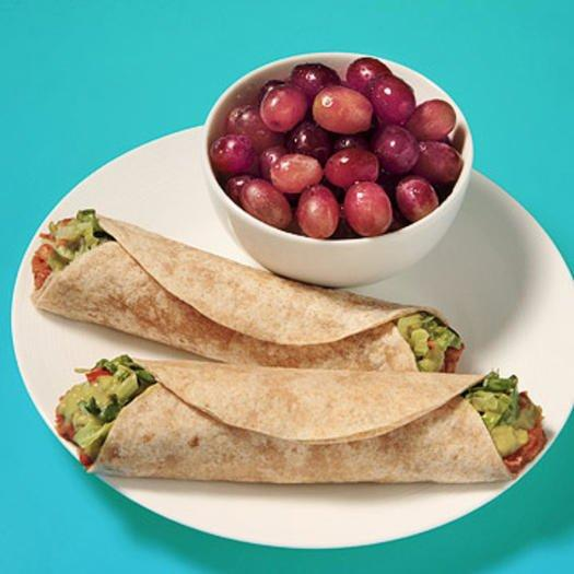"""<p>Guac on with this vegetarian 400-calorie lunch. While you're at it, go ahead and make your avocado spread a bit ~extra~ with these <a href=""""https://www.shape.com/healthy-eating/cooking-ideas/queer-eye-antoni-porowski-guacamole-recipes-hacks"""" target=""""_blank"""">tips from Queer Eye's Antoni Porowski</a>.</p> <p><strong>Ingredients </strong></p> <ul><li>1/2 cup canned low-fat refried beans</li> <li>1/4 cup salsa</li> <li>3 tablespoons guacamole</li> <li>1 cup shredded romaine lettuce</li> <li>2 small (6-inch) whole-grain tortillas</li> <li>1 cup red grapes</li> </ul><p><strong>Directions </strong></p> <ol><li>Stir together beans and salsa. Microwave for 1 to 2 minutes.</li> <li>Place warm bean mixture, guacamole, and lettuce on tortillas and roll up.</li> <li>Serve with grapes on the side</li> </ol>"""