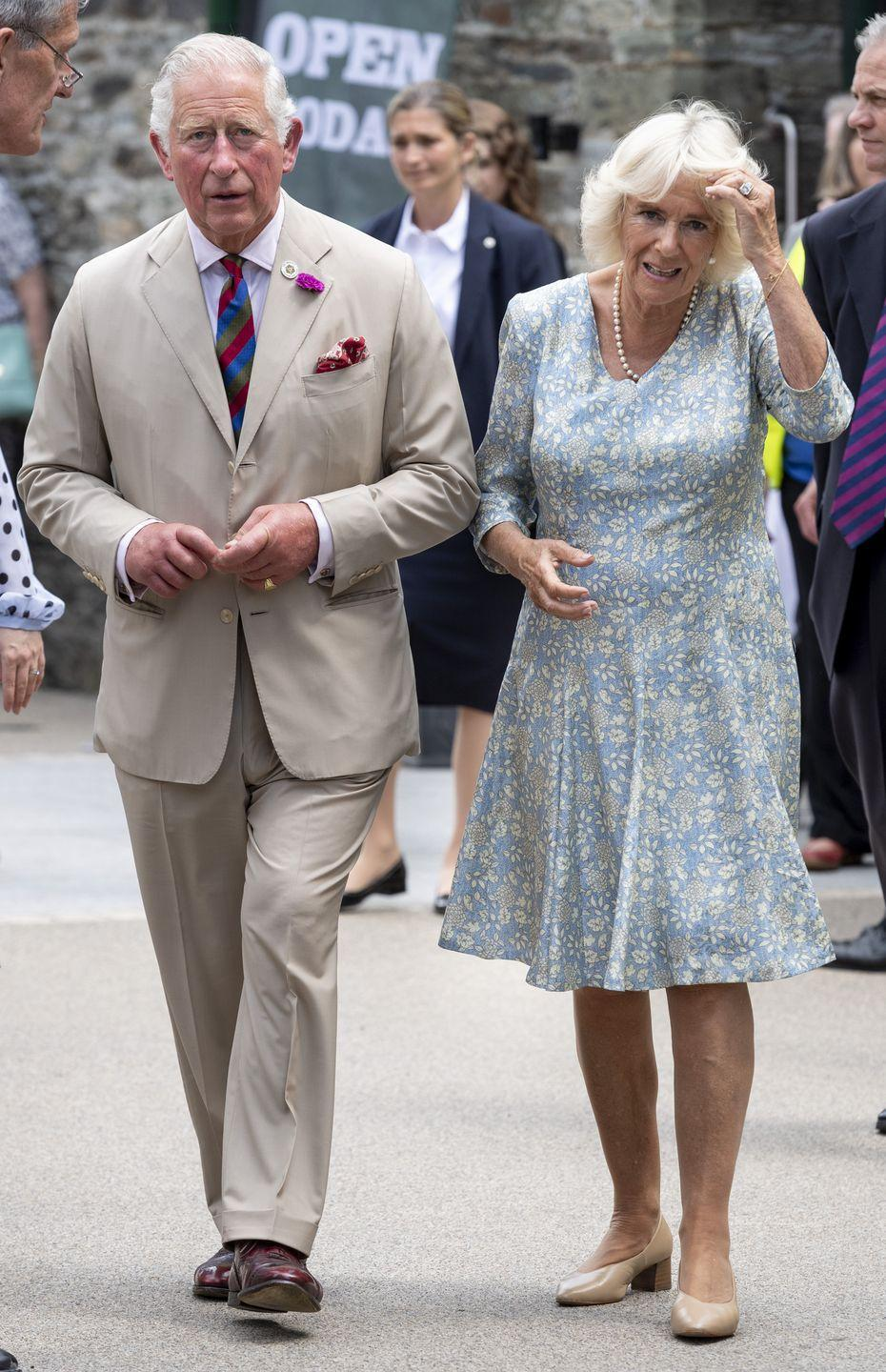 <p>During her visit to Cornwall, Camilla and Prince Charles went to the Festival of Food and Crafts. She dressed in a sky blue floral midi dress, paired with an elegant string of pearls and beige heels.</p>
