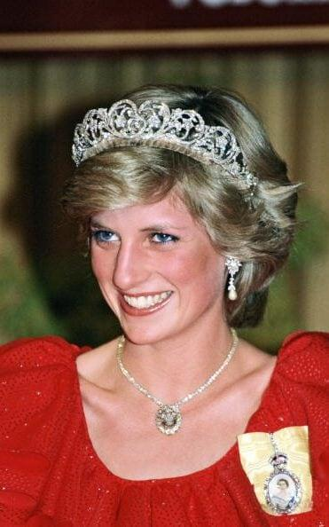 Princess Diana wearing the Prince of Wales Feathers necklace during a Royal Tour of Australia in 1983 - Tim Graham/Getty Images
