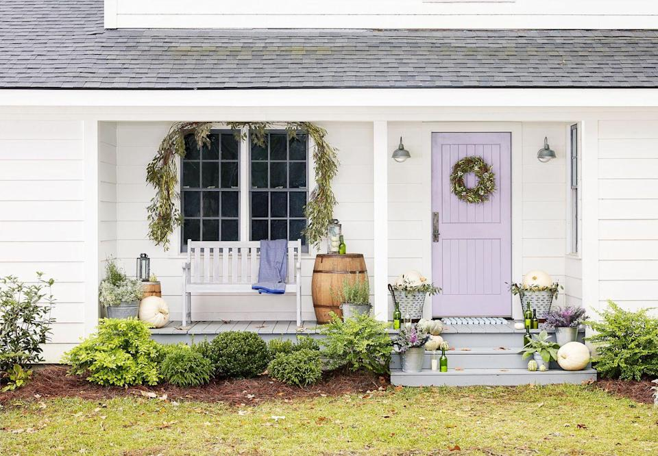 <p>Channel the California wine country with this green, white, and lavender color palette. <strong><br></strong></p><p><strong>Make the wreath:</strong> Use floral wire to bundle five or six-inch lengths of fresh olive branches together. Attach bundles to a wire wreath form, making sure the branches go in the same direction. Add dried white statice flowers here and there with floral wire.</p>